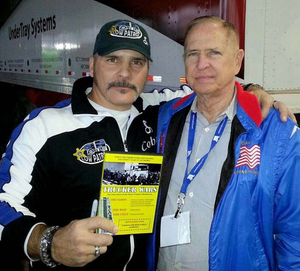 "American Trucker host Robb Mariani (left) poses here with Mike Parkhurst at the 2014 Mid-America Trucking Show. Mariani, who had been working with Parkhurst of late on a few safe-driving projects, said on his Facebook page that Parkhurst was ""a true champion for the industry."""