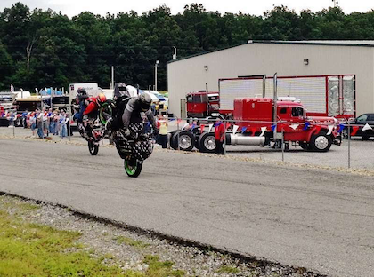 Jessie Toler and fellow rider mid-stoppie