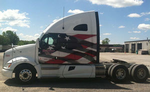 Owner-operator Lindom's 2011 Kenworth T700 is one of two Baylor-leased tractors the owner, a military veteran, chose to decorate in Patriotic colors.