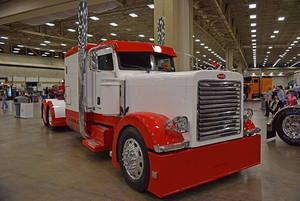 "Catch a gallery of images of Ron Brubaker's 1993 ""One of a Kind"" Peterbilt 379 as well as his son Dan's green 2014 389 glider via this link."