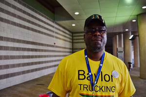 Owner-operator Richard C. Lindom Sr. of Baylor Trucking, among company reps facilitating the Keep on Trucking for ALS Ice Bucket Challenge at GATS.