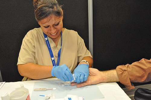 The test involves a painless fingerstick blood sample, with results available in 20 minutes.