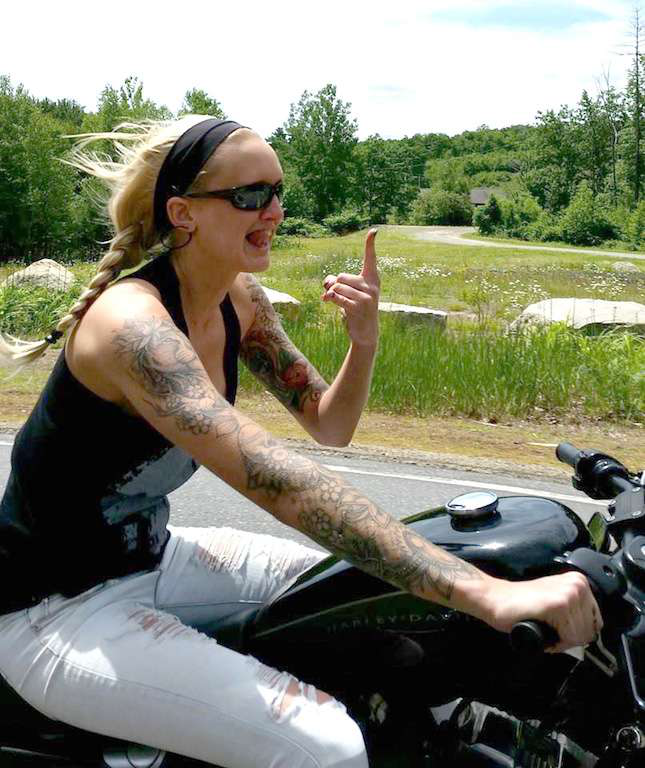 Sometimes Weymouth trades 18 wheels for two – on a motorcycle or a dirt bike. Weymouth gets lots of notice for the tattoos on her arms and back.