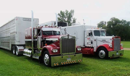 """Davis' older rig, the 1988 Freightliner at right (which you can read more about via this Channel 19 post), bagged the 2nd-place trophy in its class. """"The A model KW"""" also pictured here, noted Davis, """"won 1st place and well deserved it at that."""" Who'd Davis cast his vote for? The KW, no doubt, he says."""