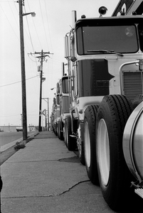 """""""The Kenworth dealer was right across the street from the Dart terminal in St. Paul, and I used to go over and eye the new K100s all the time. If I'd have been smart I would have taken the money I'd saved and gotten into a better truck, and stayed with Dart running for myself. I guess I just wasn't mature enough to know the difference yet."""" --Craig Ryan on the KW dealer pictured above in the 1970s"""
