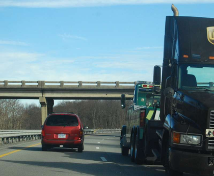 Truck being towed on highway