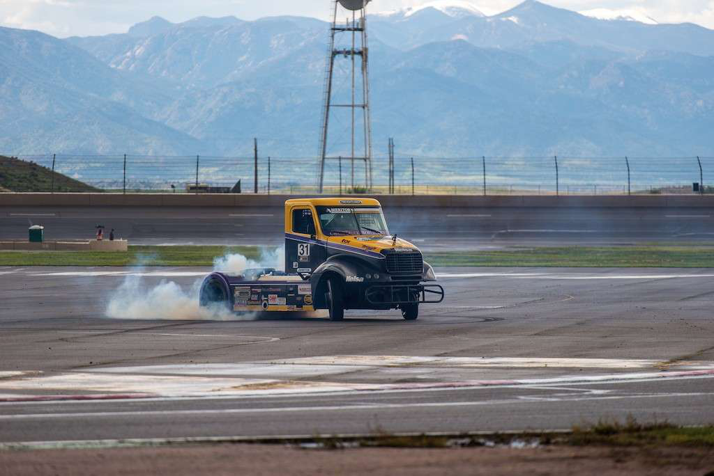Stuart Oliver drove ChampTruck's company truck, the No. 31 Freightliner, to victory in the points-earning Podium Race at Pikes Peak raceway in May.