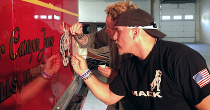 McKay, Mariani at work on some detail paint on the Mack.