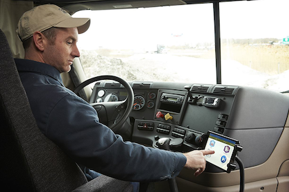 """J.J. Keller & Associates' Encompass system (also pictured at top) can be paired with the company's specially designed tablet or with operators' personal Android or iOS devices. Tom Reader, J.J. Keller marketing director, believes the company is well-positioned. """"We're in virtually every truck stop in the country,"""" he says. """"We have a really good track record in the owner-operator market with paper logs. Right now, the electronic log at truck stops? We're not there yet."""" But it's coming soon. The engine connection retails at about $200."""
