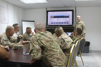 Staff Sgt. Baker on August 13, 2015, instructing a group of soldiers of the 1313th on how to obtain and use a CDL.