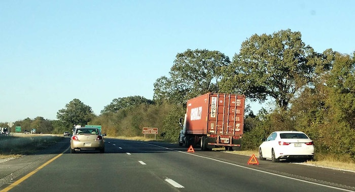 intermodal-truck-on-side-of-highway-breakdown-with-triangles