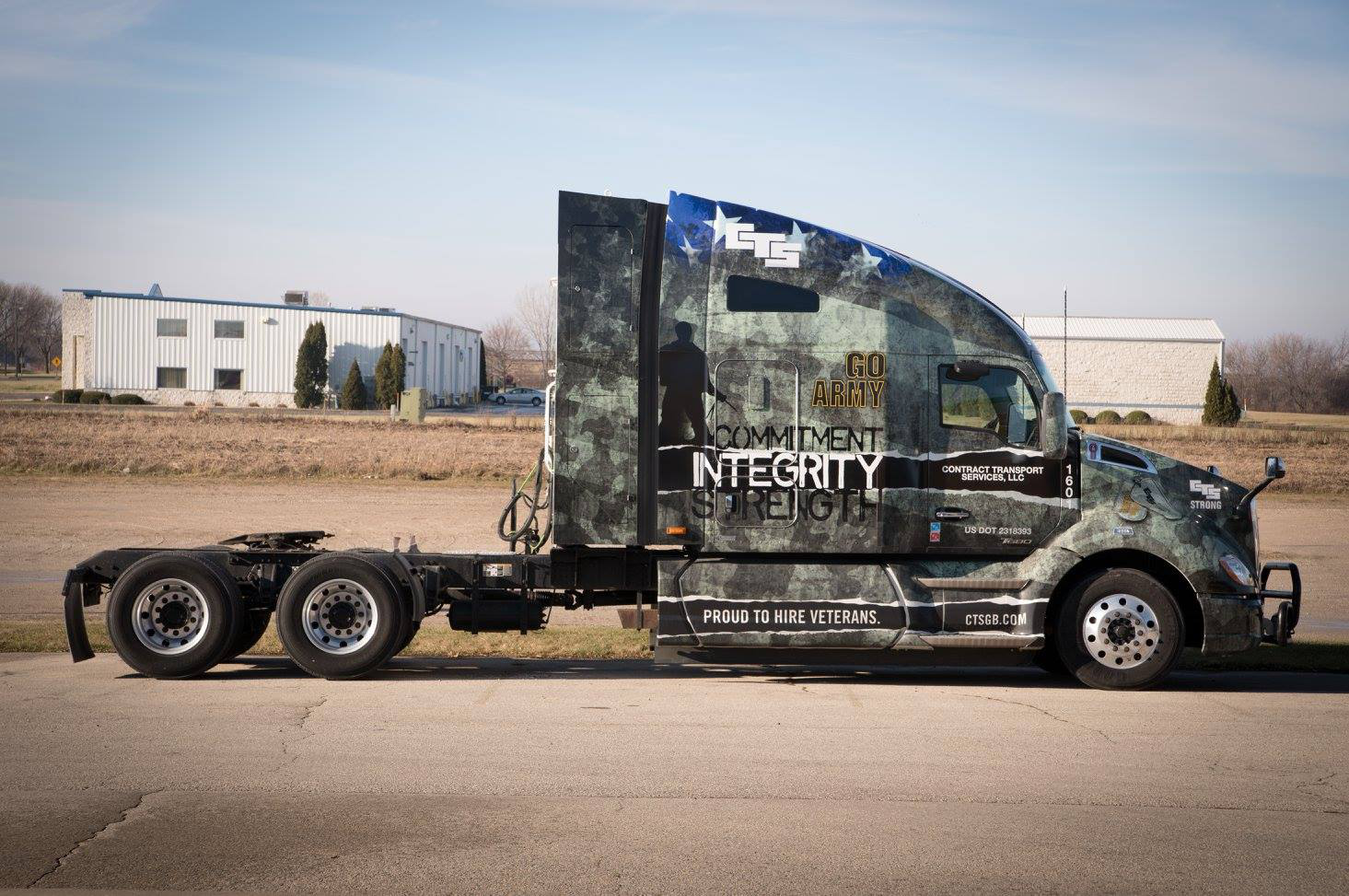 Trucking company honoring vets with military-themed wraps