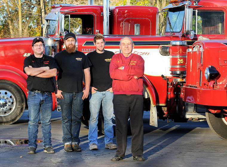 Dick Smith (right) with, from left, his son Rich and grandsons Rob and Kevin