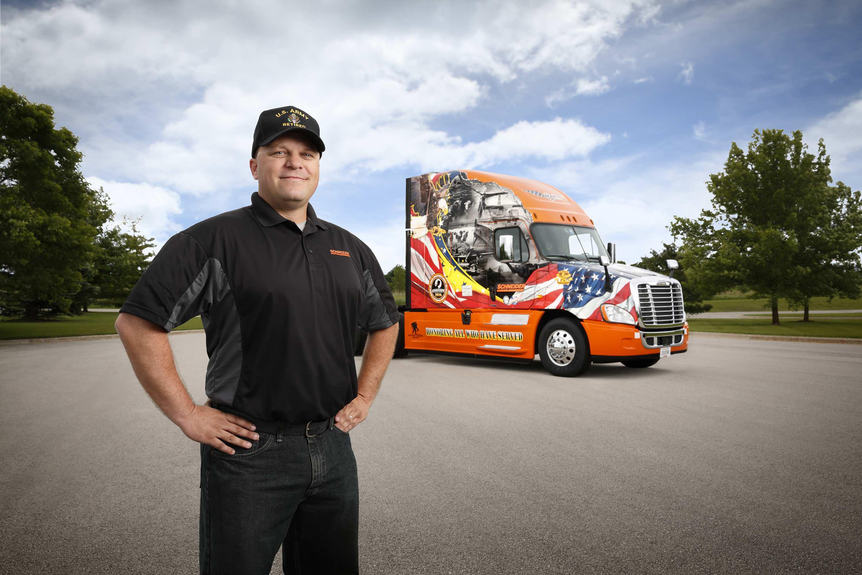 Schneider driver Jon Ritscher drives this year's Freightliner Ride of Pride truck.