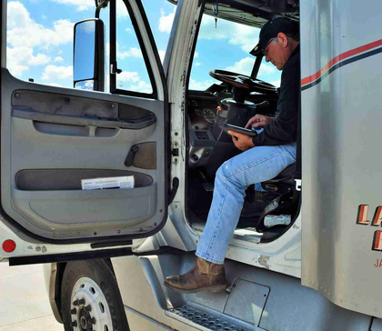 Buchs checks in on the load board during the two-hour unload at the tail end of the run. He was planning then not the next load, which he's pick up early the next morning, but looking farther down the line to the one after that.