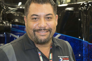 Roland Mendez standing with Project TOC on the show floor at GATS.