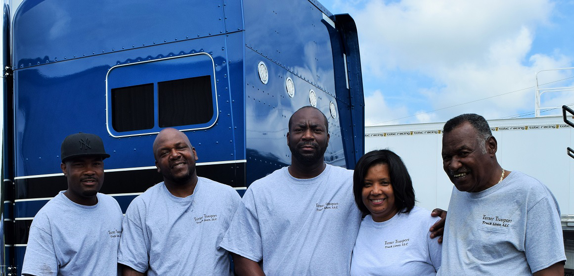 "Part of the Atlanta-based Turner Transport team: From left, drivers Dane Thomas and Warren Wiseman, owners Eric and Stacy Turner, and Stacy's father, McKinley ""Doc"" Hayward."