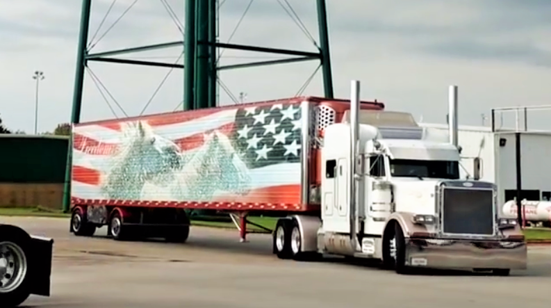 That's Reed's Peterbilt pulling Wisconsin-based Jerry Kissinger's patriotically decorated reefer trailer. Reed's known Kissinger for years, he says, part of the reason he, by a path too circuitous to do justice, so to speak, here, got involved with the convoy after showing at the preceding Guilty By Association Truck Show down the road at 4 State Trucks.