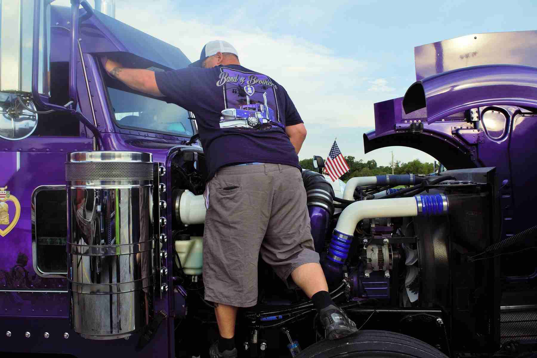 """Army veteran and Purple Heart recipient after his military convoy was ambushed in Iraq early this century, owner-operator Sean McEndree today runs in this """"Band of Brothers"""" patriotically decorated custom rig. Stay tuned for more on the 2006 Peterbilt 379, which he piloted in the """"Stars, Stripes and White Lines"""" convoy, and custom work by DB Kustom Trucks, among other suppliers"""