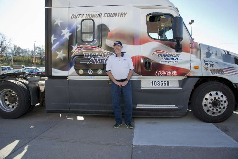 Transport America recognized one of their drivers and military veteran, Robert Harp, on Veterans Day with a custom military truck wrap.