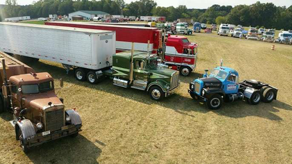 Staging on Hollywood Hill with Brad Wike's Duel Peterbilt, the Rubber Duck Mack from Convoy (owned by tktk) and Paul and Craig Sagehorn's Movin' On and B.J. & the Bear KW conventional and cabover, respectively.