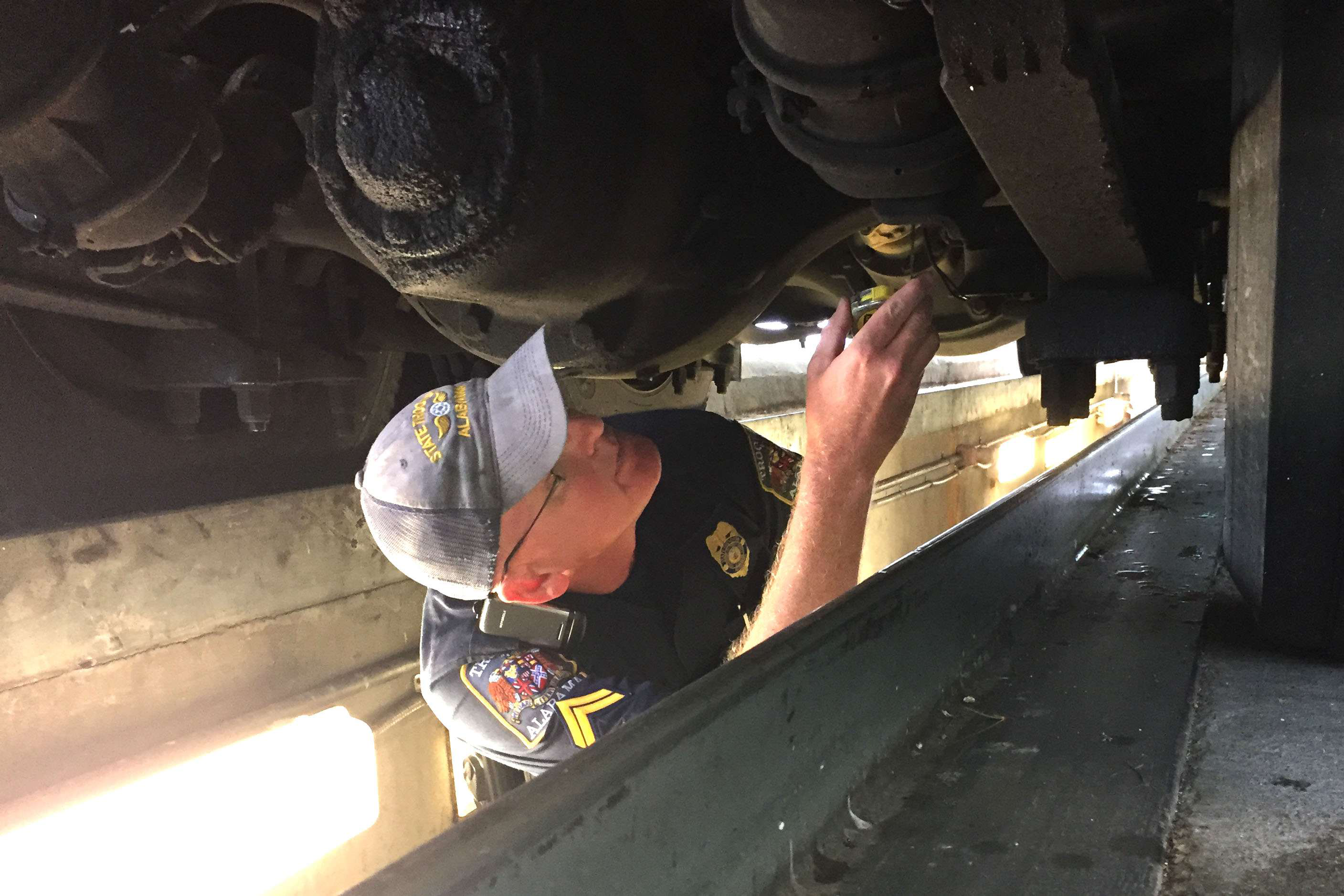 Inspector Chris McNatt checks a chassis at Alabama's weigh station near the Georgia state line Tuesday, the opening day of International Roadcheck.