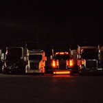 Truck stop parking lot at night