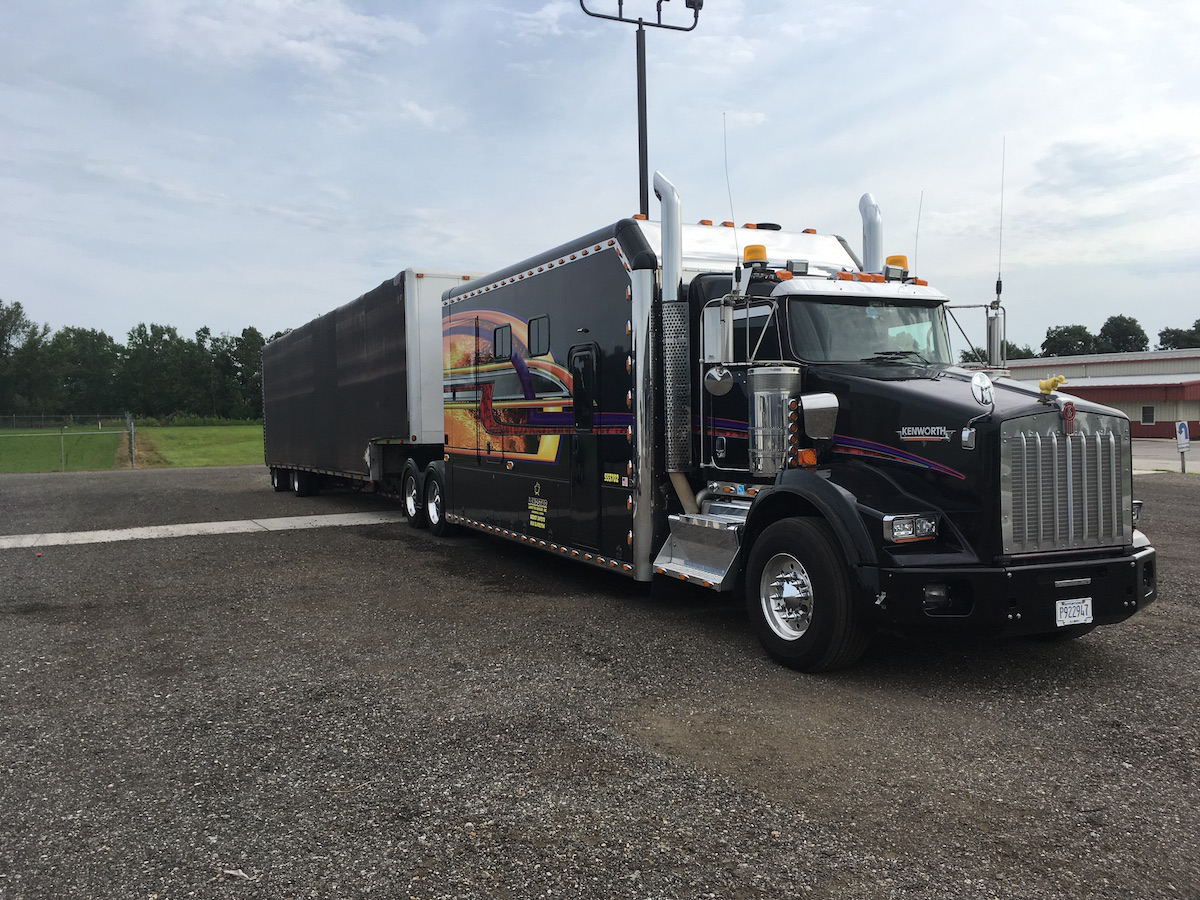Ron and Liz Arguin's 2014 Kenworth T800 features a 230-inch ARI sleeper,  which includes a five-foot garage with a Rampage power lift for Ron's 2014  Indian ...