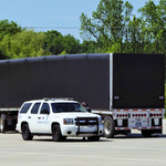 Semi-truck with police car inspection
