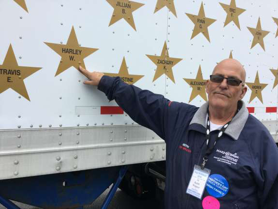 Keith Wagner pointing the a star honoring his late granddaughter on his trailer