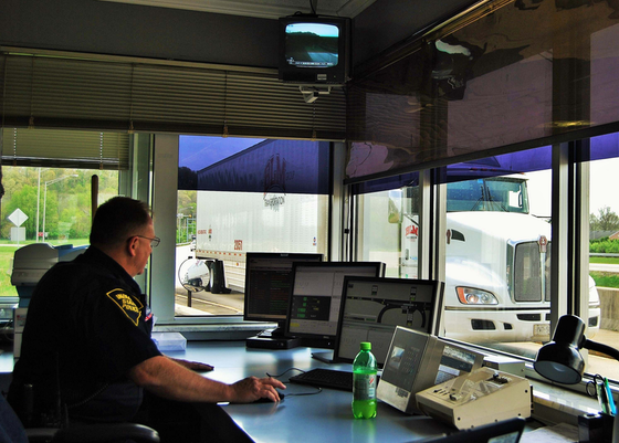 Weigh bypass inspection station officer behind desk