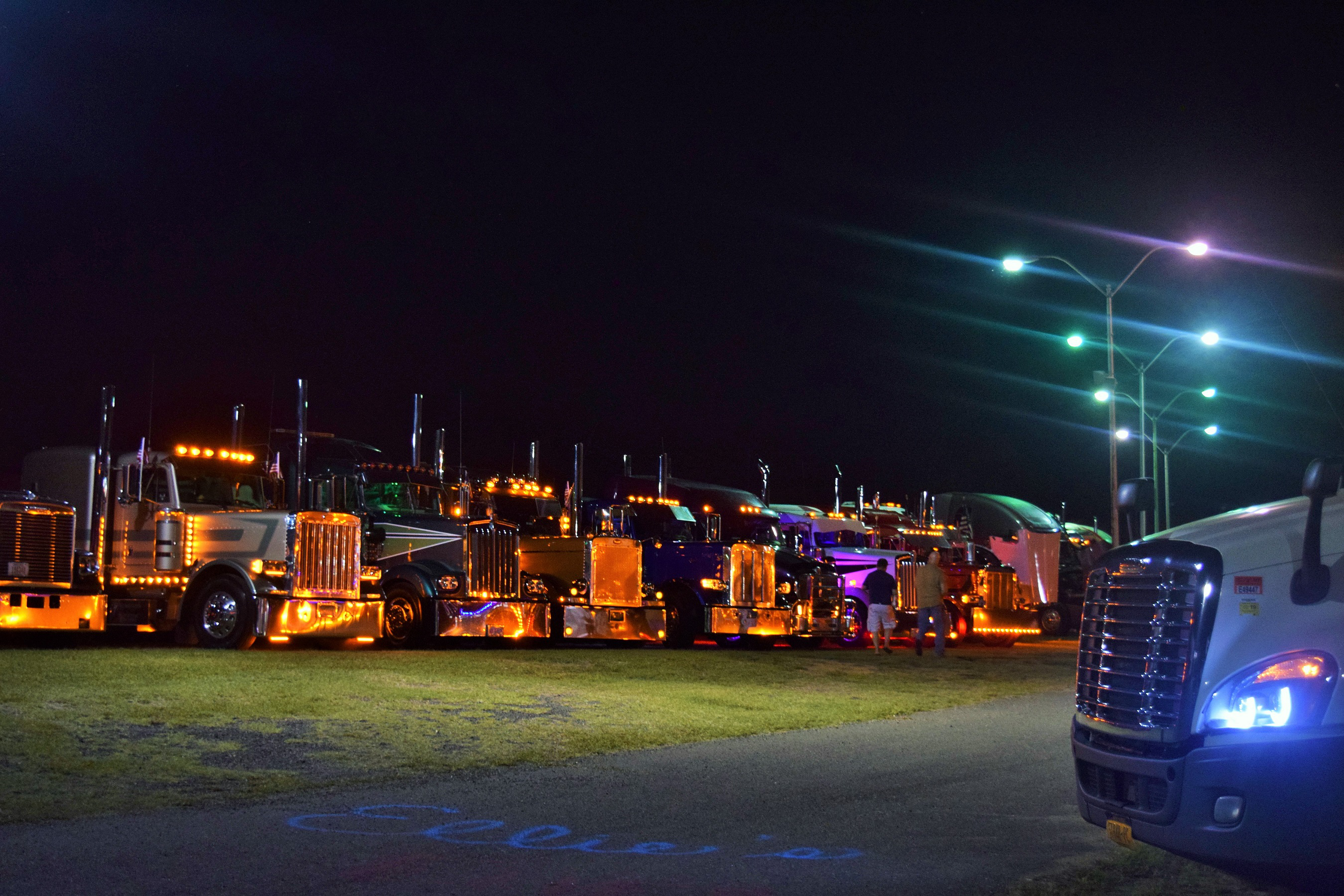 Multiple semi-trucks parked in lot