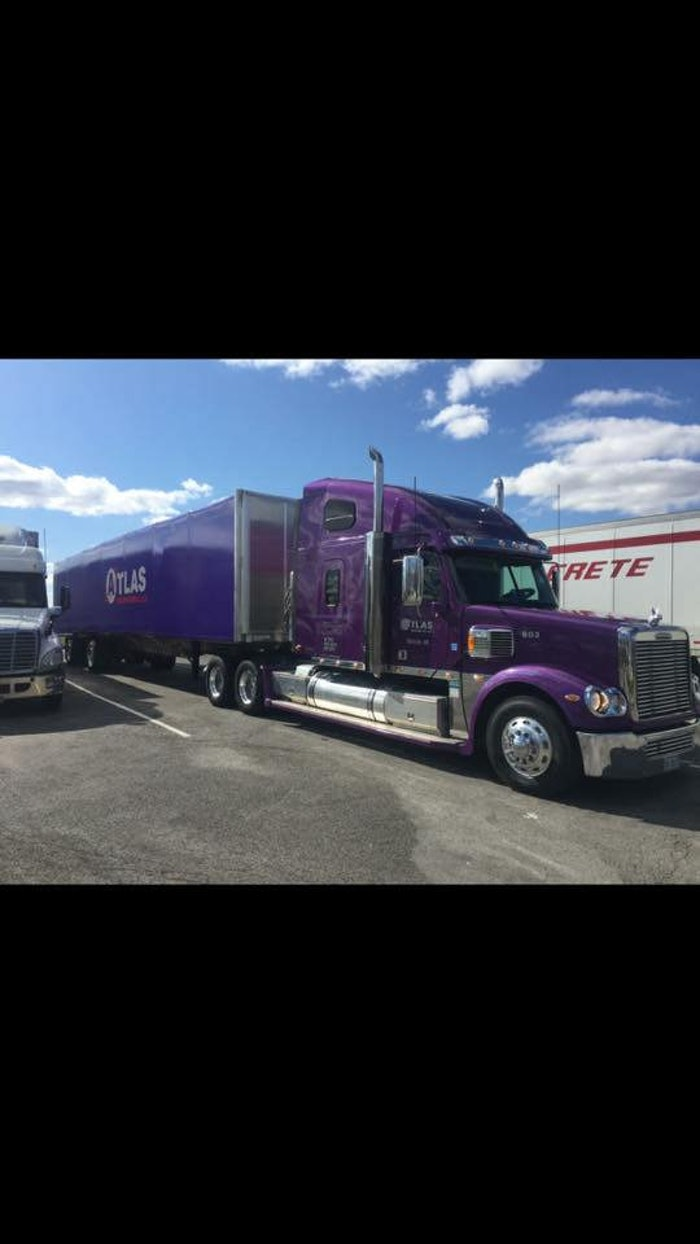 Atlas Trucking Eight Axel Trailer with Unit # 12 Peterbilt