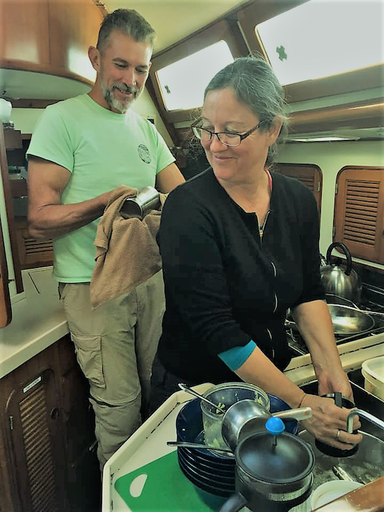 Danny and Cindy George washing dishes in their cabin