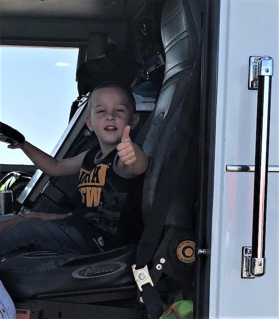 Liam Salmon inside semi truck cab