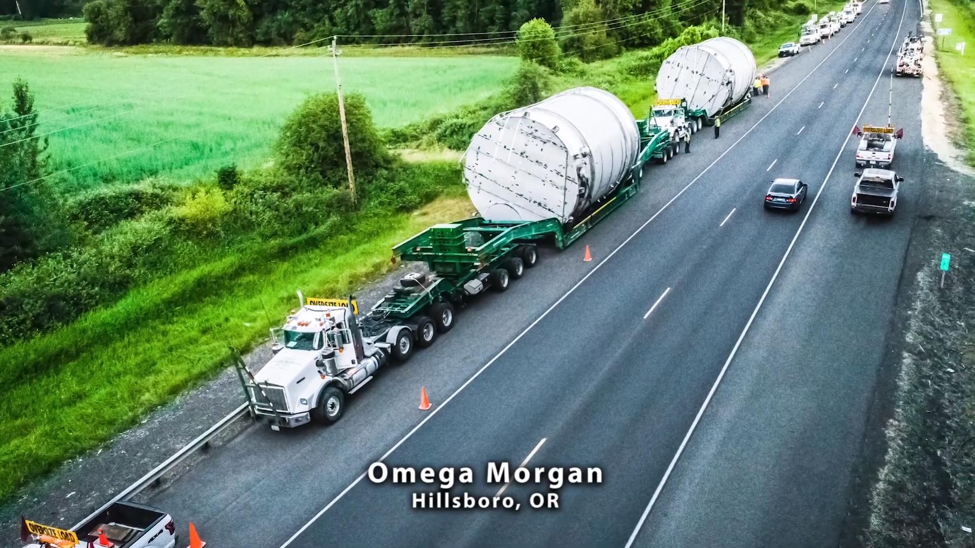 Omega Morgan transporting tanks on the highway
