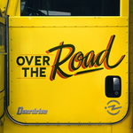 overdrive over the road podcast logo on the side of semi truck cab