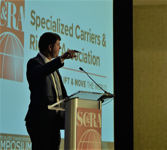Jim mullen speaking at the specialized transportation symposium