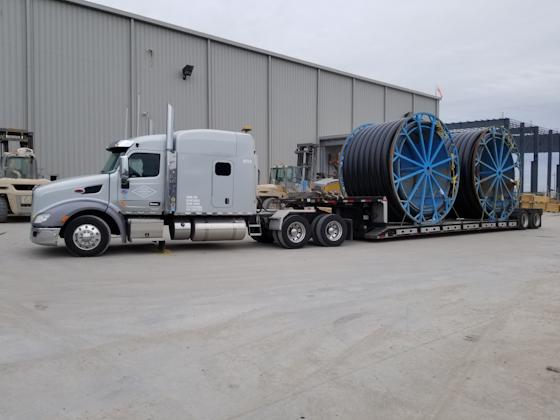 Semi truck hauling heavy duty equipment