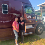Jane Moore and Pauletta Ward standing next to CLM Morris semi truck