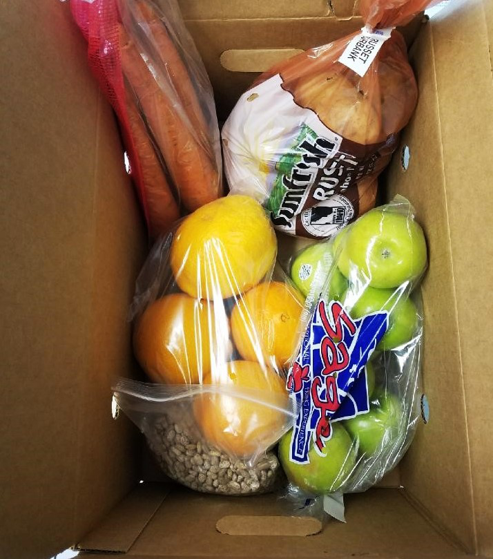 Fruits and vegetables in a cardboard box