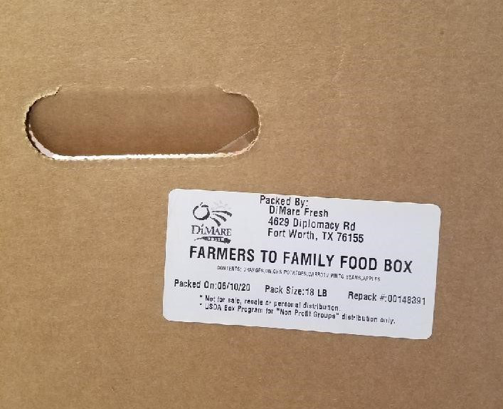 Farmer to Family Food Box label on a cardboard box