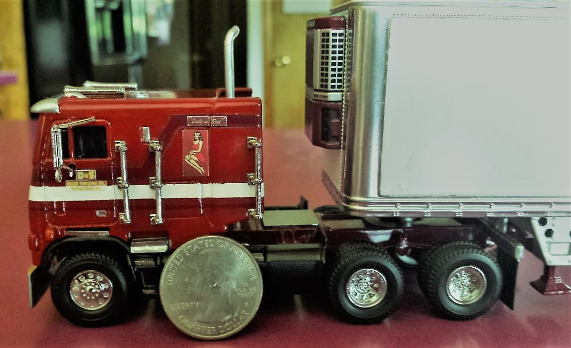 Scale model of Steve and Doris Bixler's 1989 Freightliner Cabover, the Lady in Red, with quarter for size comparison