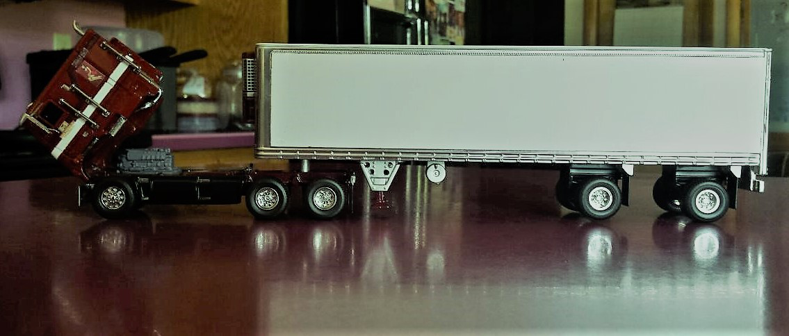 Complete scale model of the Lady in Red cabover with trailer