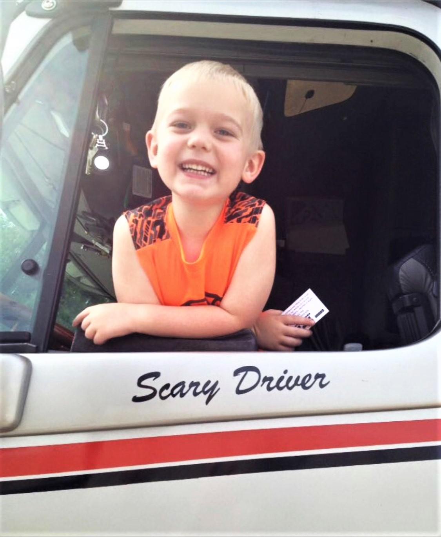 kid inside semi truck