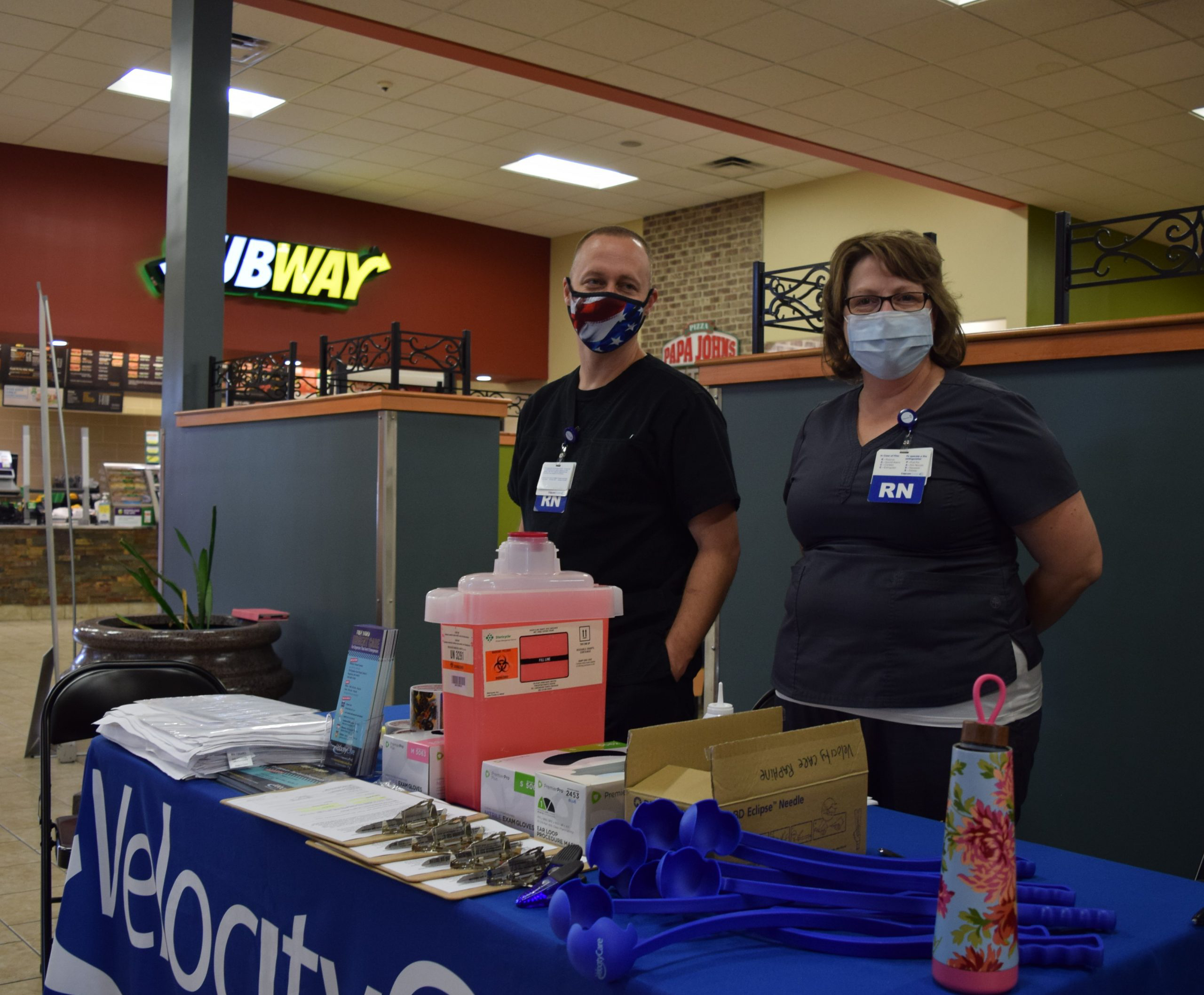 Carillion Clinic RNs distributing masks, sanitizer, and more, as well as offering free flu shots