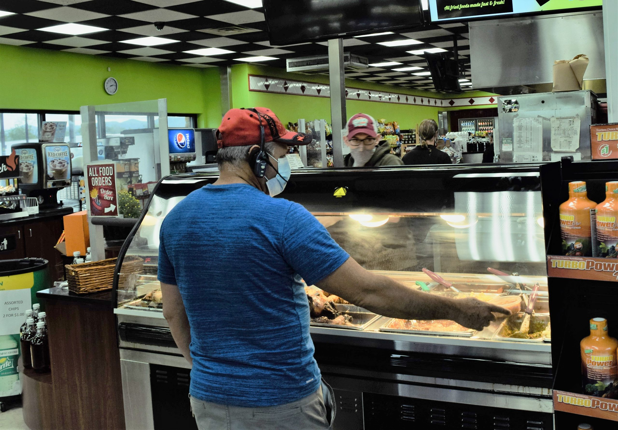 Man ordering food at the deli in White's Travel Center