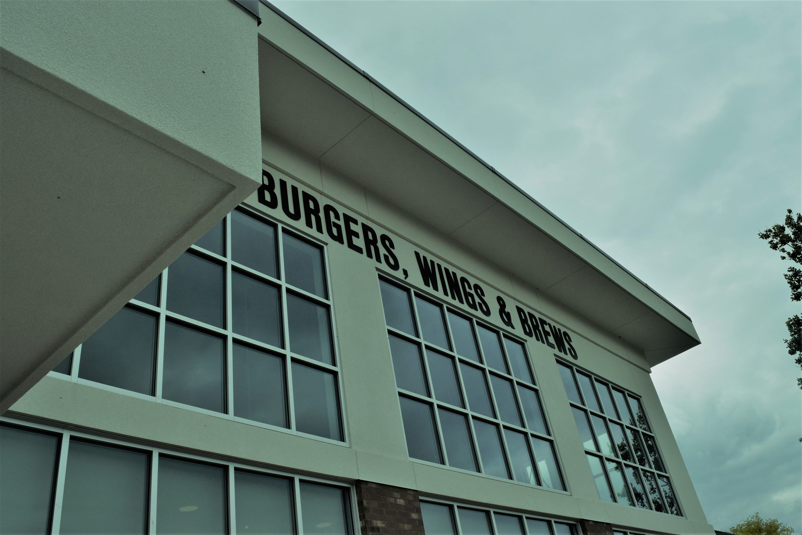 Burgers, Wings, and Brews sign on the side of the new Quaker Steak and Lube Restaurant