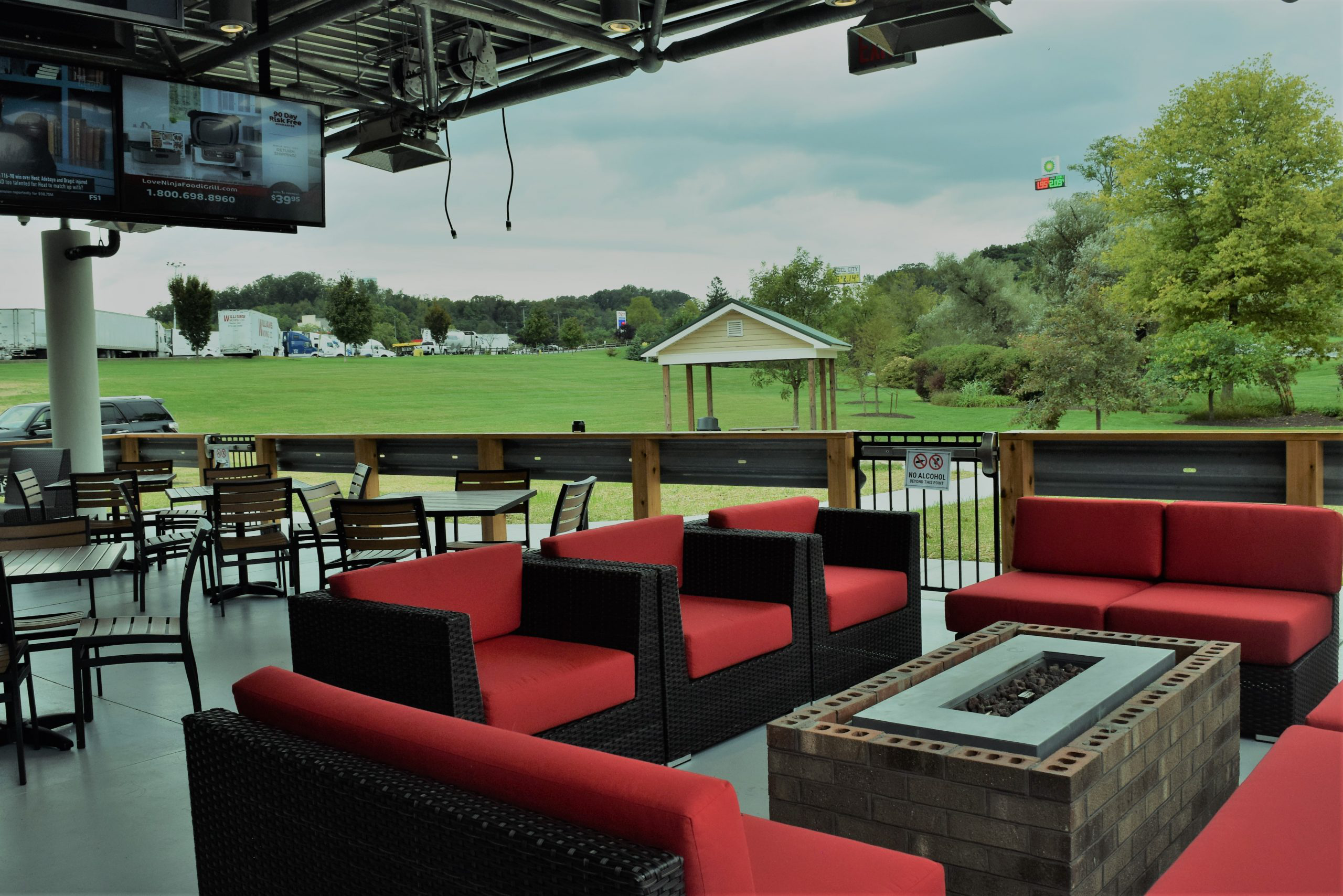 Outdoor seating and fire pit at Quaker Steak and Lube Restaurant