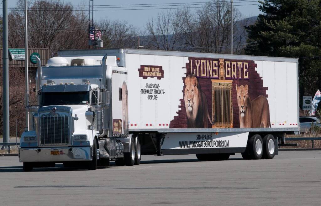 Jose Williams Lyons Gate 2007 Kenworth semi truck and trailer